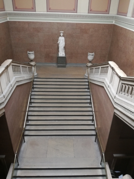 Looking down at stairs leading up to Europe galleries