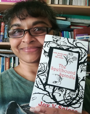 Me holding copy of 'The Spellbound Spindle'