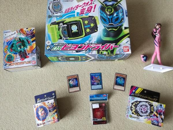 Gordon's loot - Kamen Rider, Yu-Gi-Oh cards, Evangelion figure