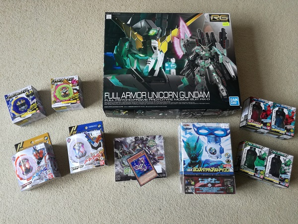 Liam's loot - Gundam (requires assembly), Kamen Rider (one of which includes a DVD), Yu-Gi-Oh cards