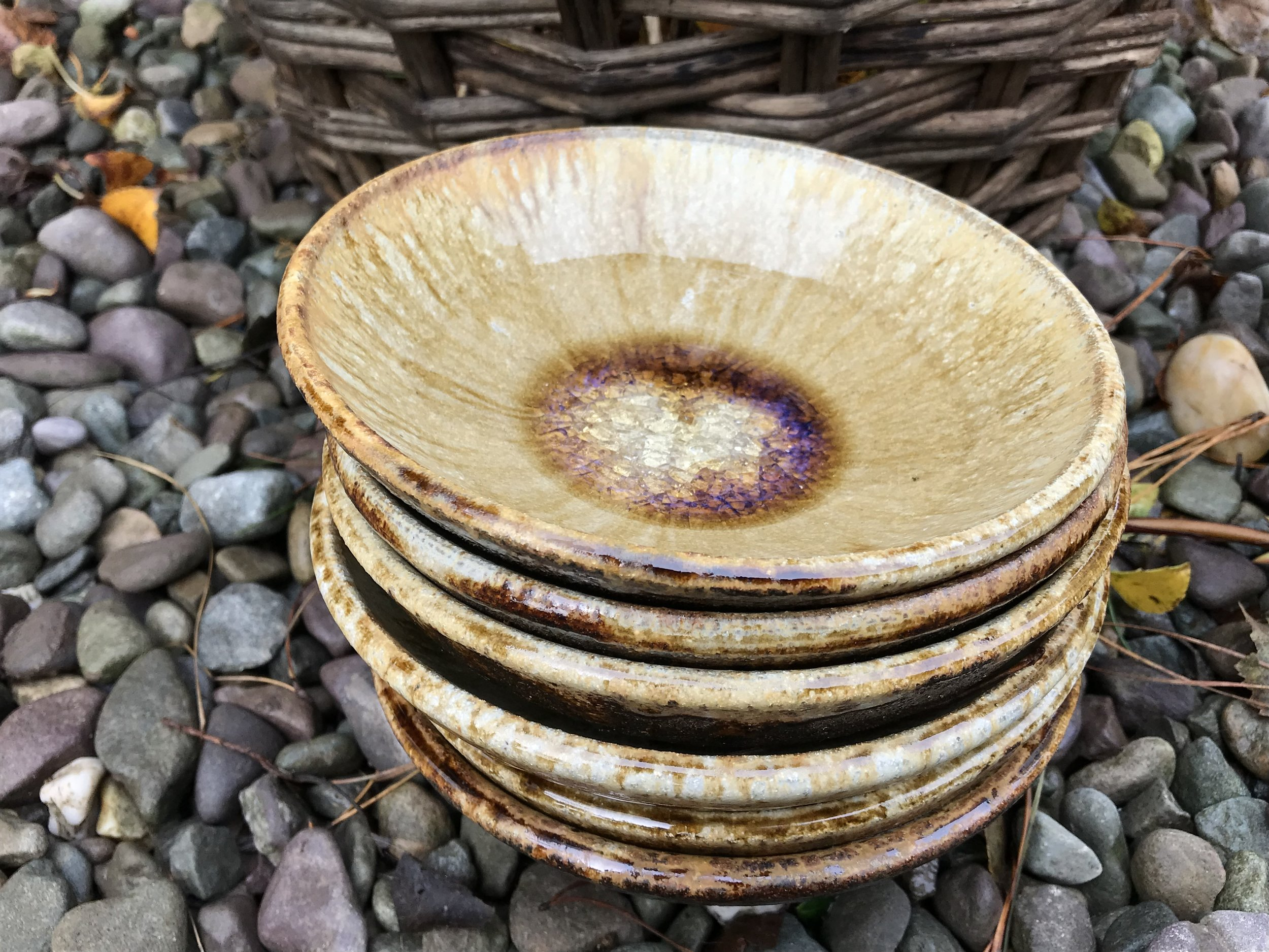 Wood ash was dusting around the rim of these bowls