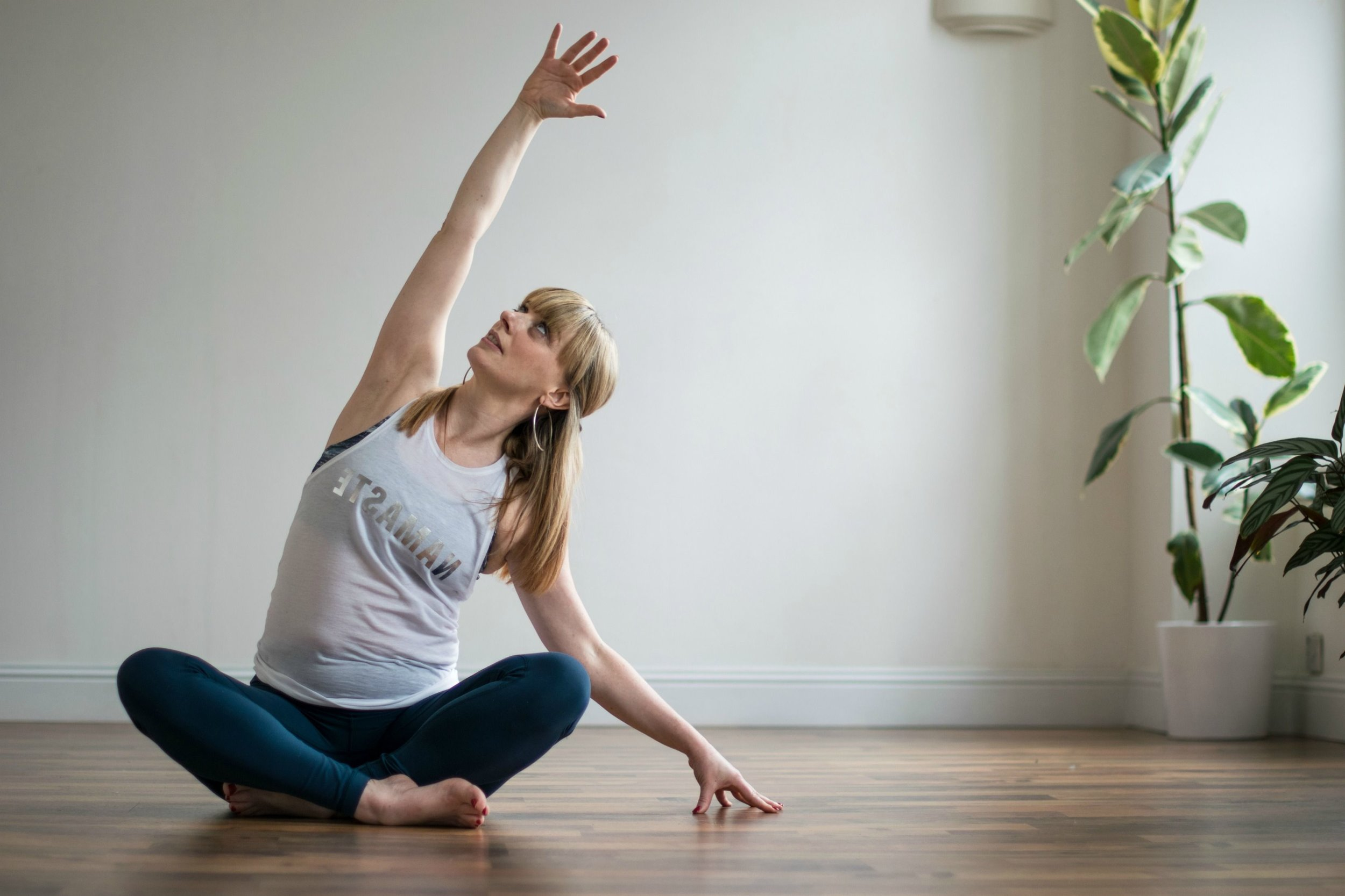 Michelle Lang Yoga Teacher in seated side bend