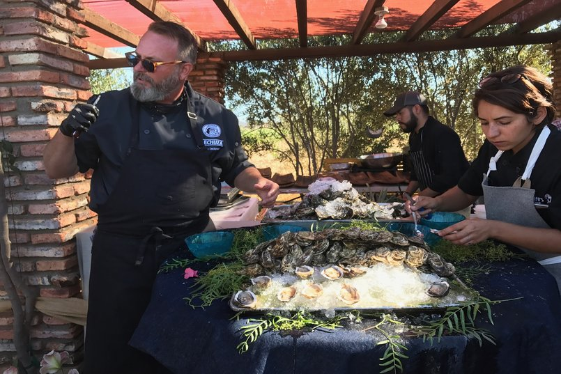 Drew Deckman tending to his oysters