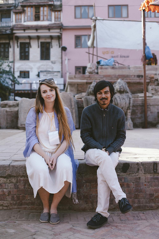 Hanna , wearing the gift from Pramila, sitting with Bichitra in Patan's square in Kathmandu