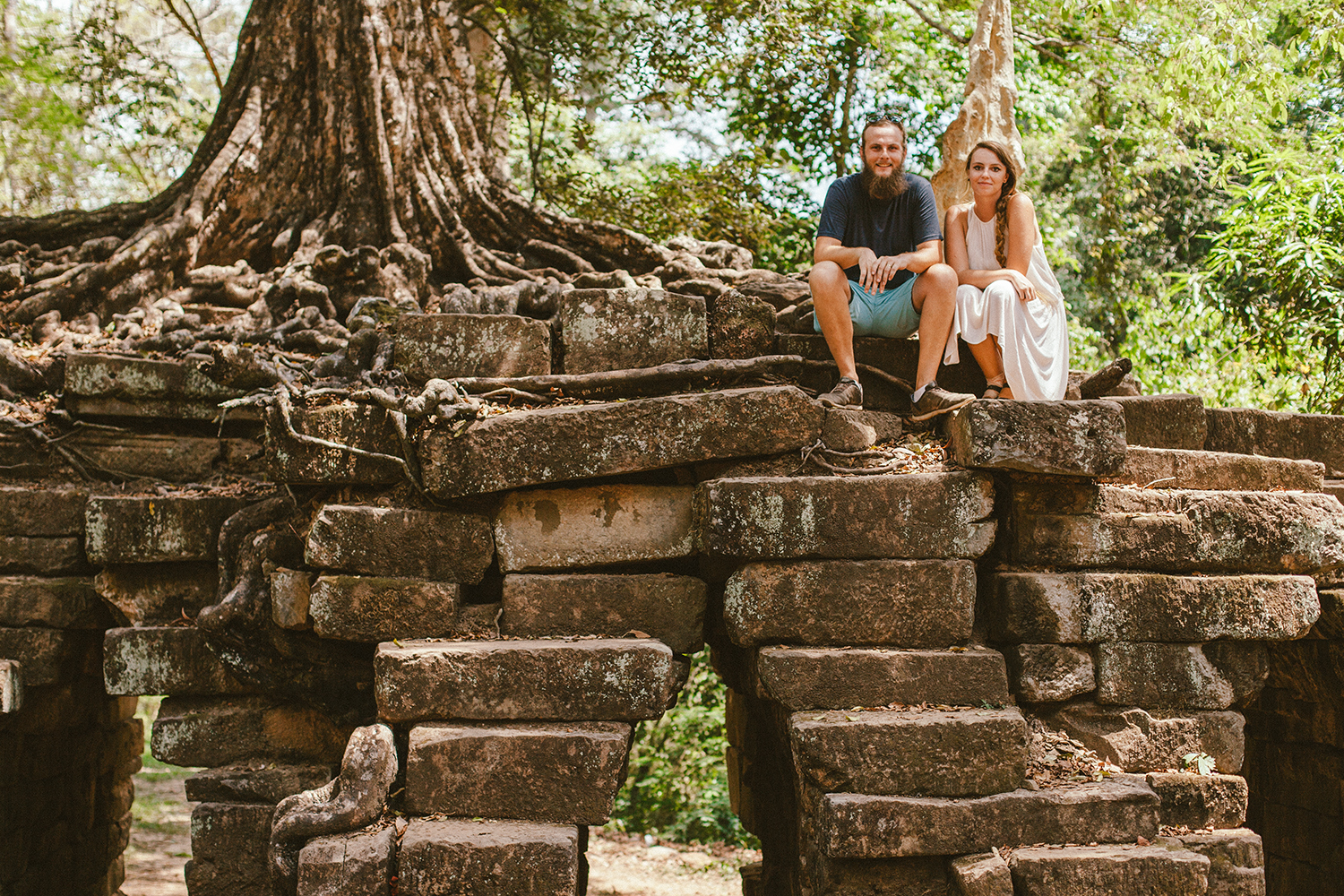 Sitting near an amazing tree on the way from Bayon Temple, in Siem Reap