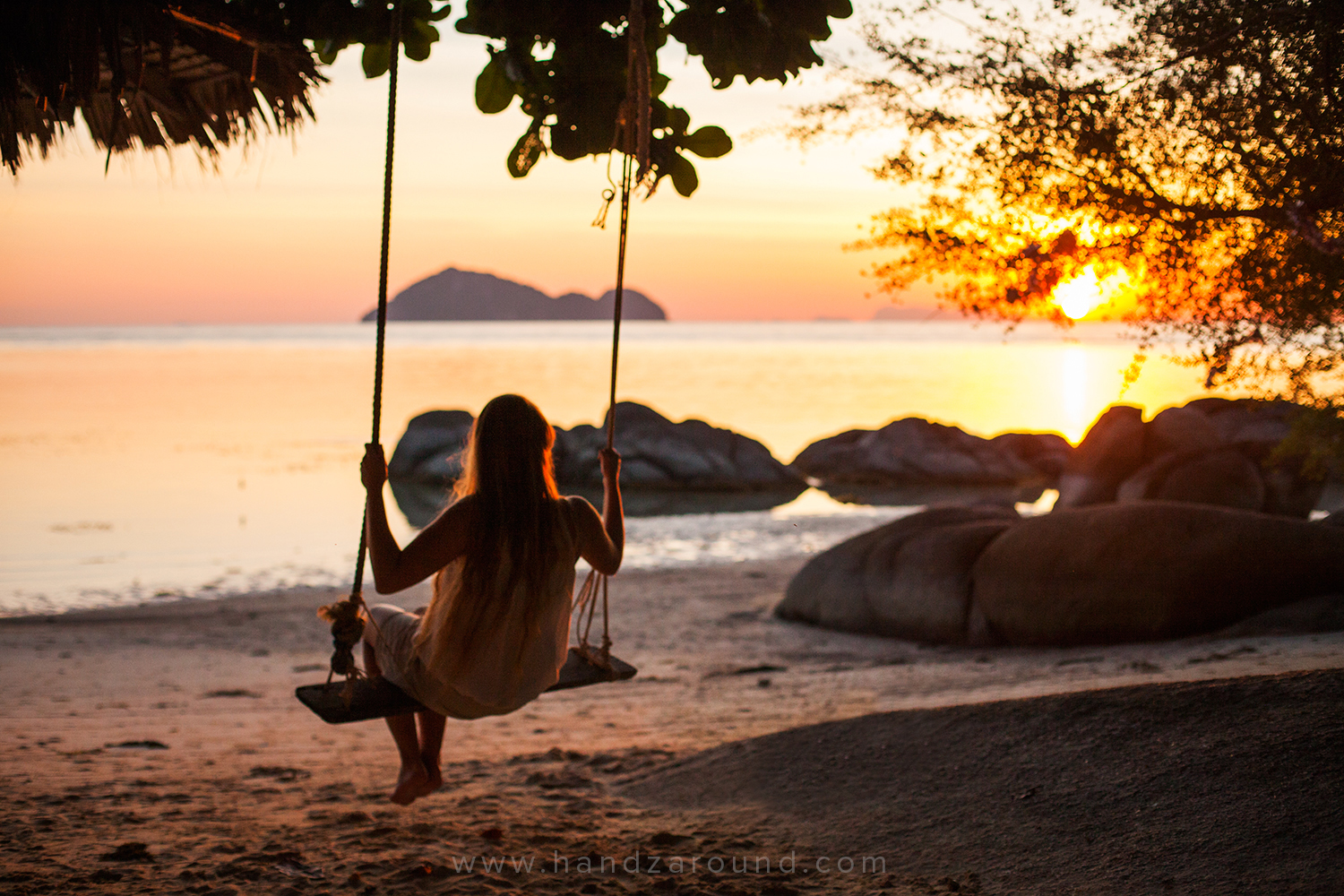Hanna swinging in Koh Phangan, Thailand. It's better to spend your travel budget on things like this, rather than on hospital, so a good travel insurance makes all the difference.