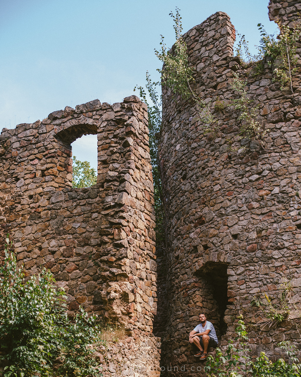 Zach looking at the ruins of the Cisy Castle