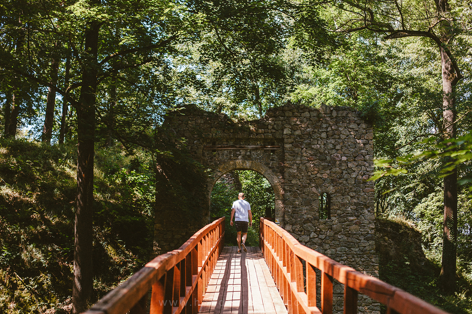 Zach walking towards ruins of Cisy Castle in South West Poland