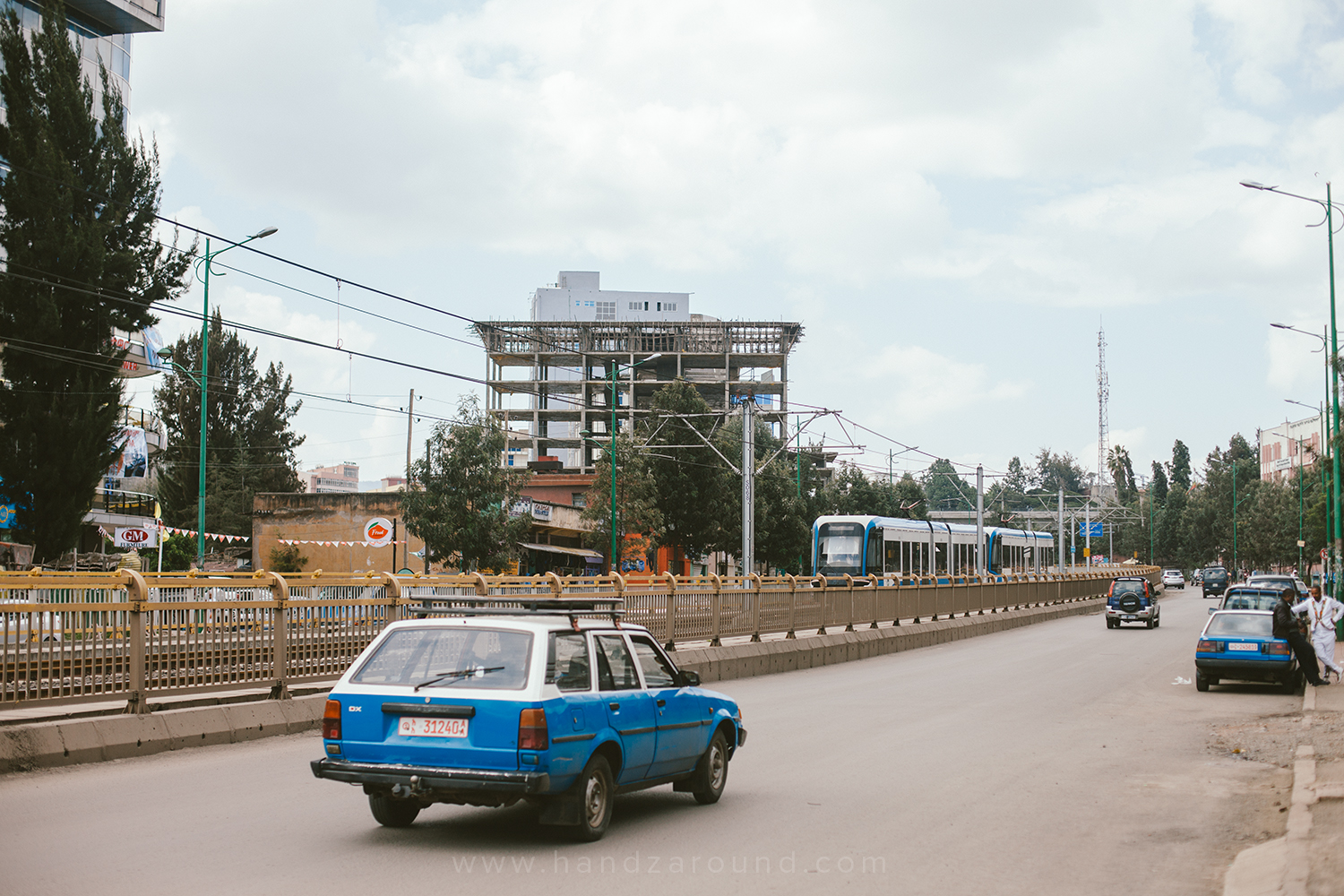 Electric train and taxis in the centre of Addis Ababa