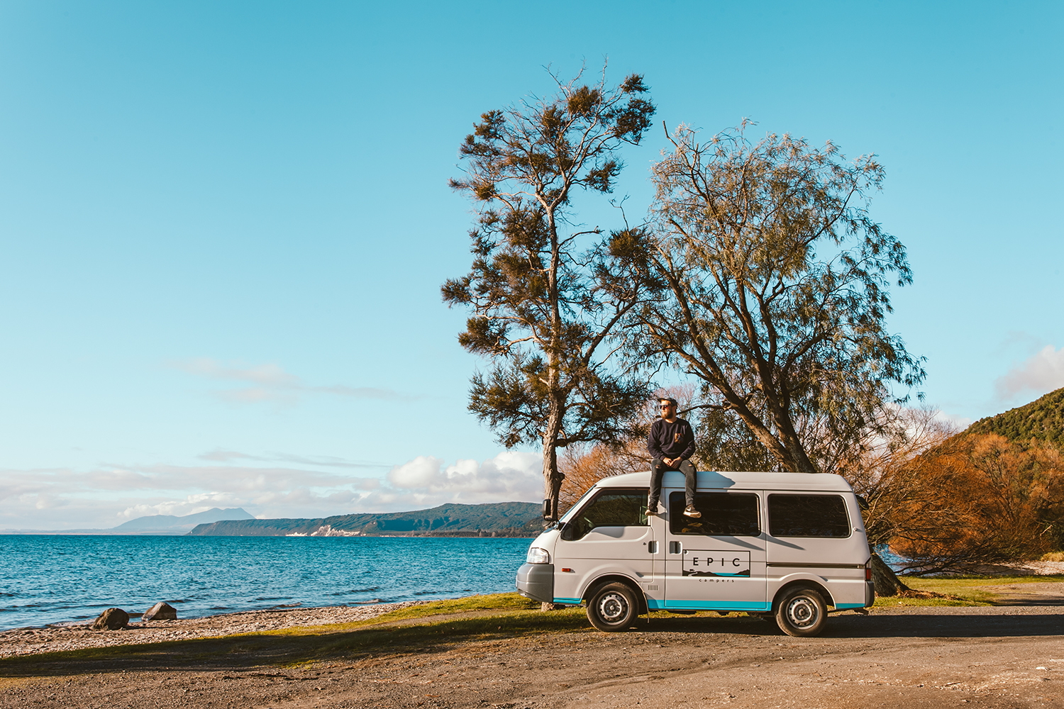 Zach & our Epic Camper at the shore of Lake Taupo