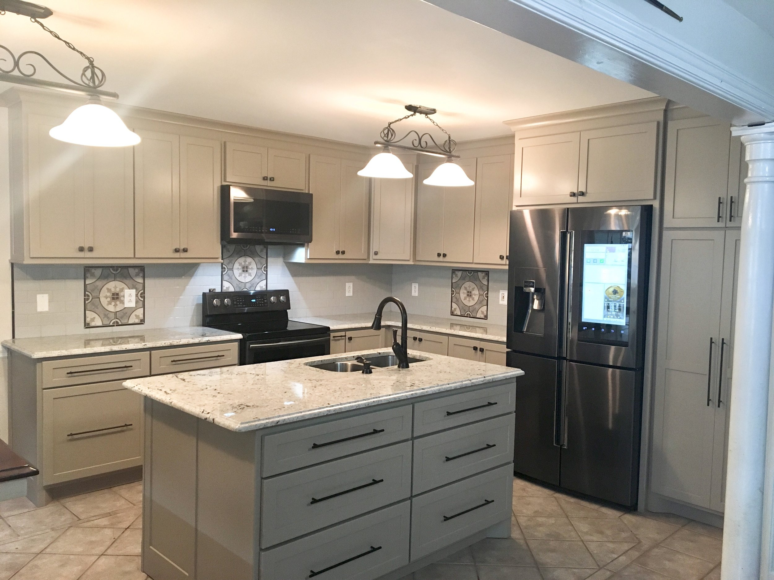 Front view of kitchen and island.