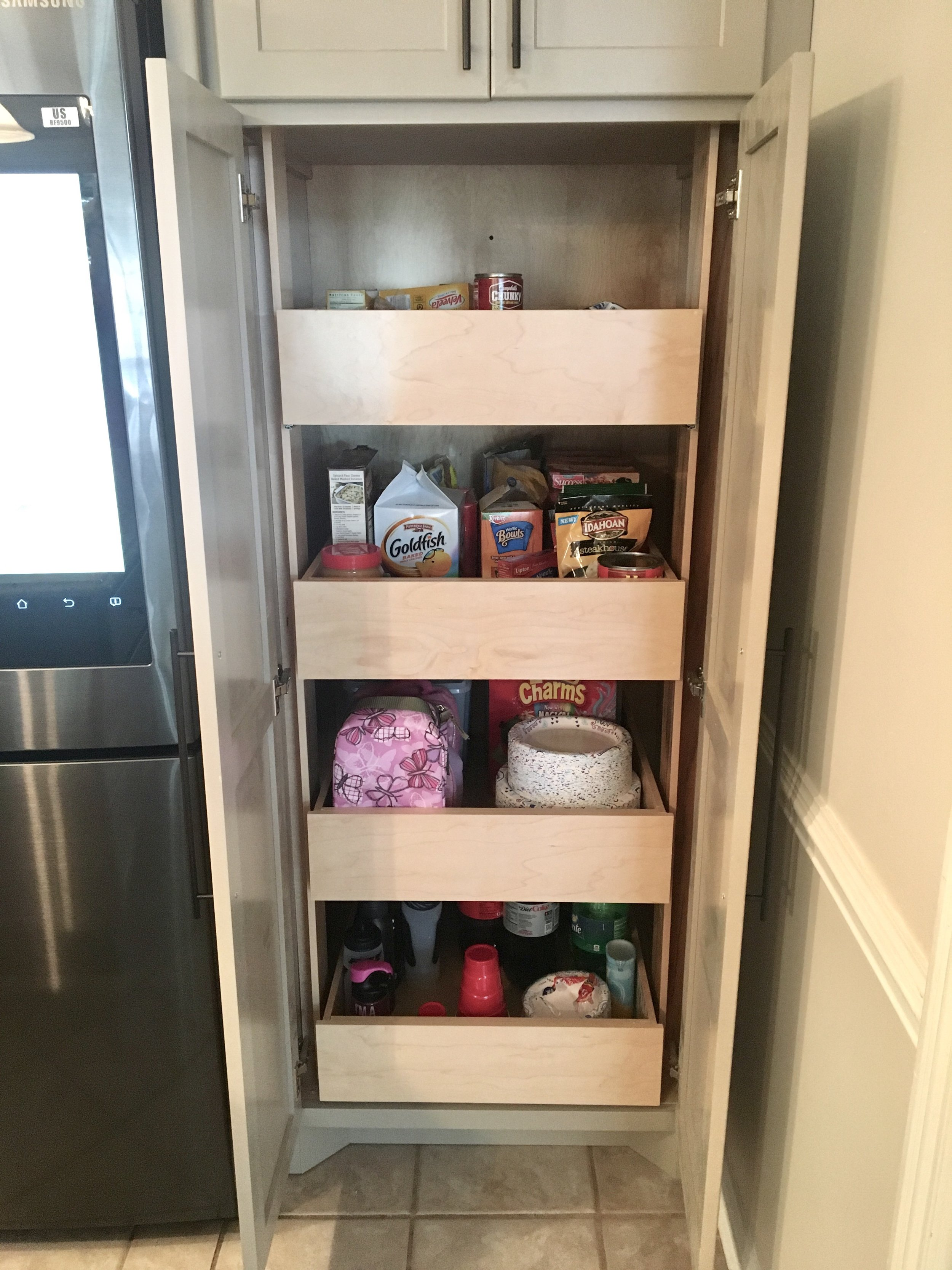 Our custom designed pantry pullout with four deep shelves.