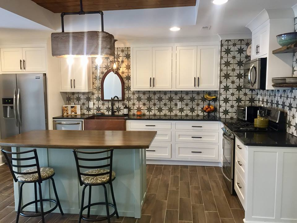 Example of statement backsplash and sink in a farmhouse kitchen.