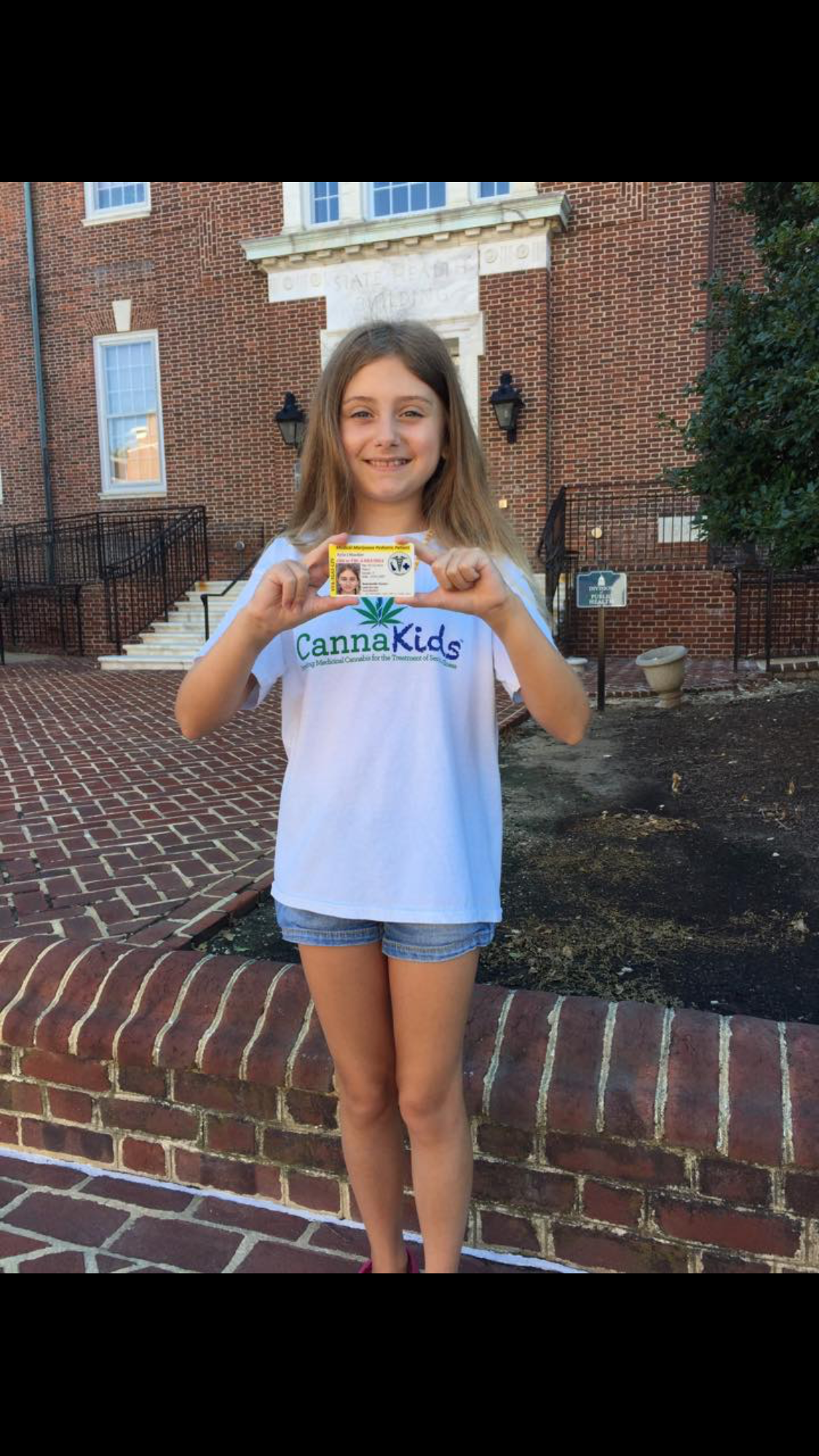 - Riley Maedler holding her medical cannabis card in her home state of Delaware. After Riley was helped, her mother lobbied to change the laws in the state, with great success.