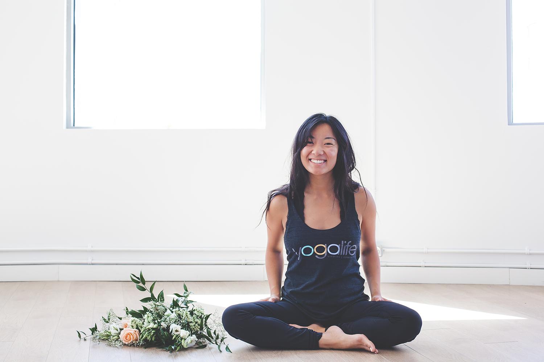 edmonton yogi sitting with flowers