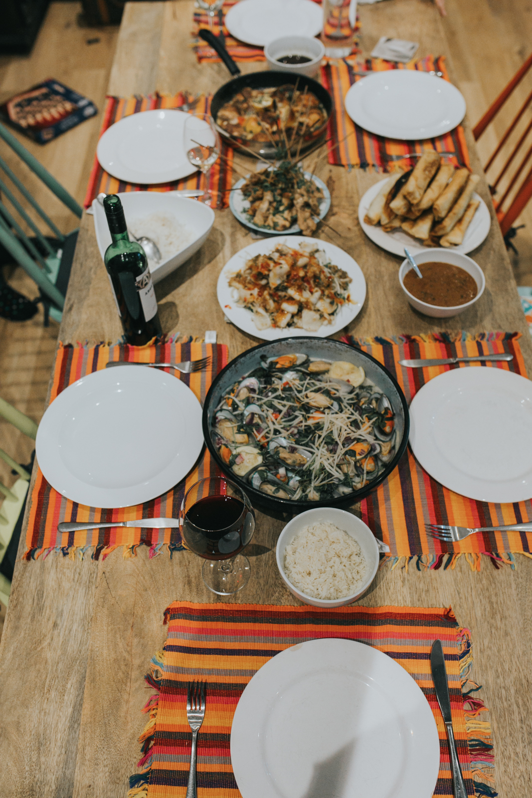 Mussels in Coconut Milk, Spicy Squid Salad, Spring Rolls, Chicken and Pork Satay and Baked Lemon Chicken