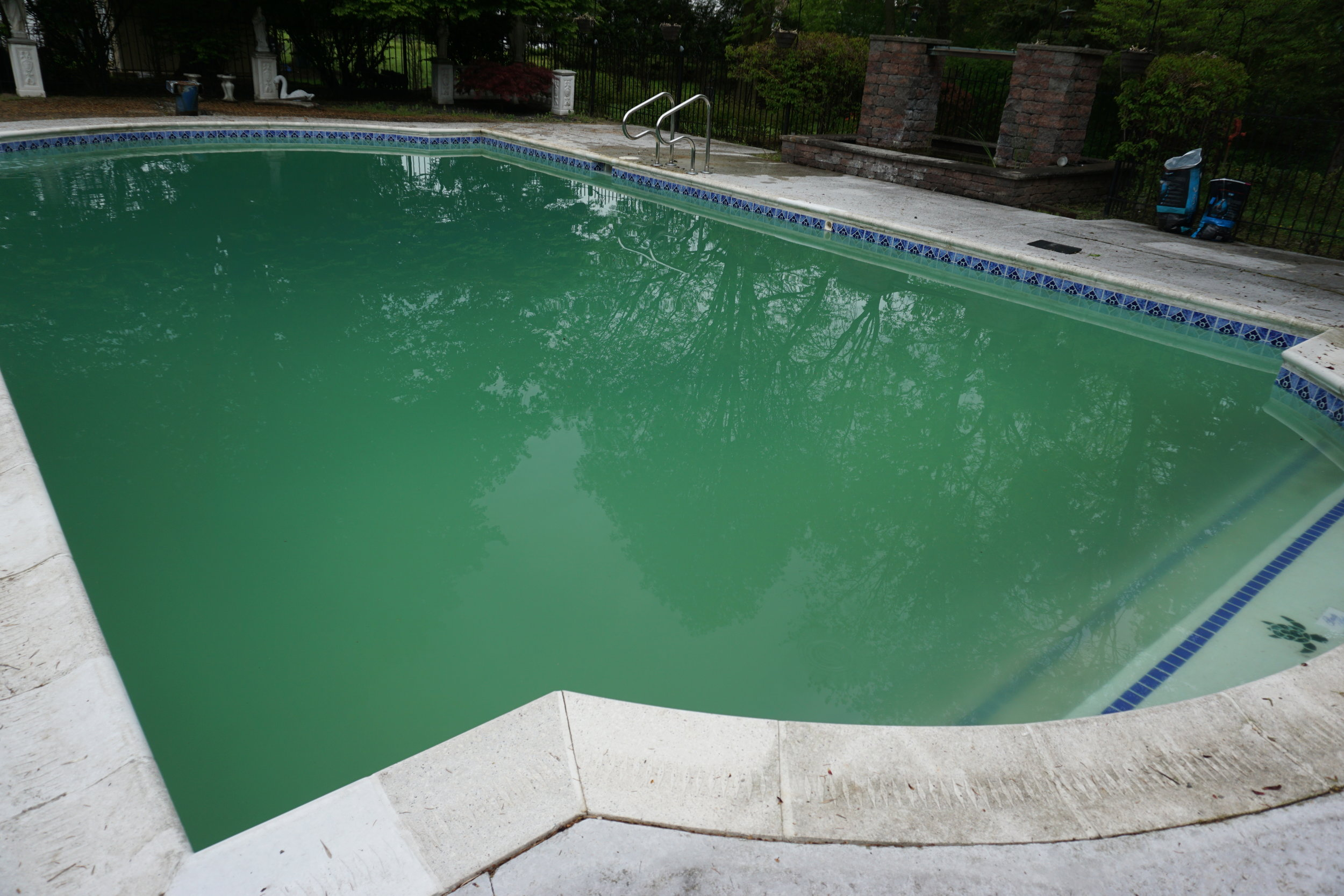 After a heavy shock treatment and brushing, the water was very foggy requiring Power Floc™