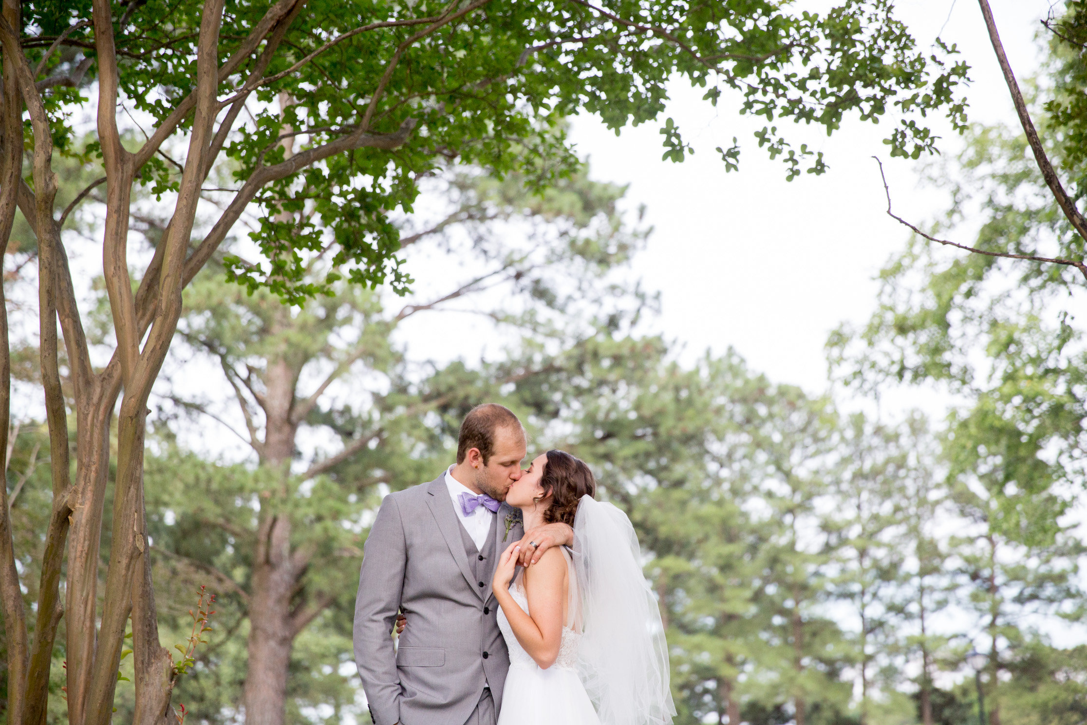 Logan and Laura pose for some gorgeous shots outside Colonial Country Club before their wedding ceremony.