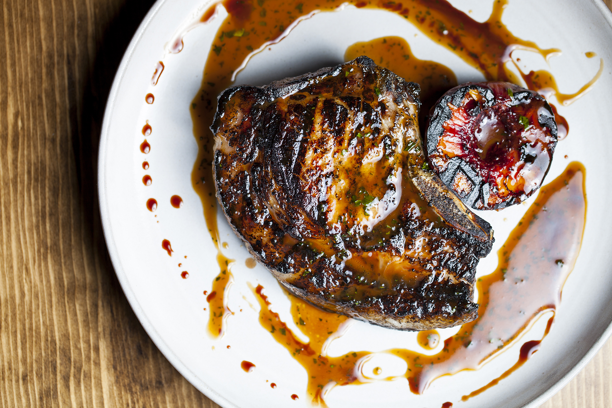 Wood grilled pead & barnett pork chop with fig and brown butter