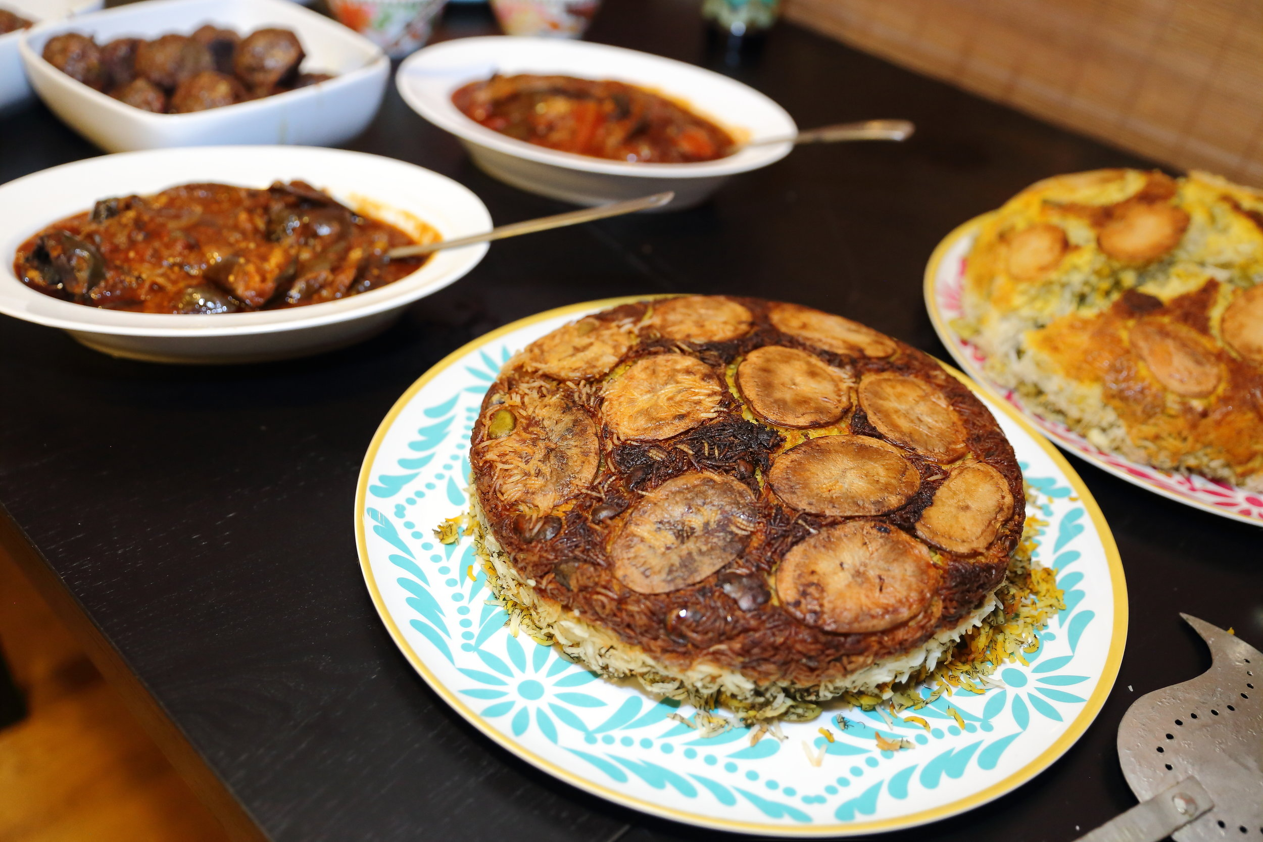 "One of the dill & fava bean rice dishes I made for last Saturday's dinner.  The crust is made with saffron, yogurt and potatoes embedded in the crunchy rice. In Farsi, this is called ""Tahdig"" which means ""bottom of the pot"".  Photo credit:  Tina June"
