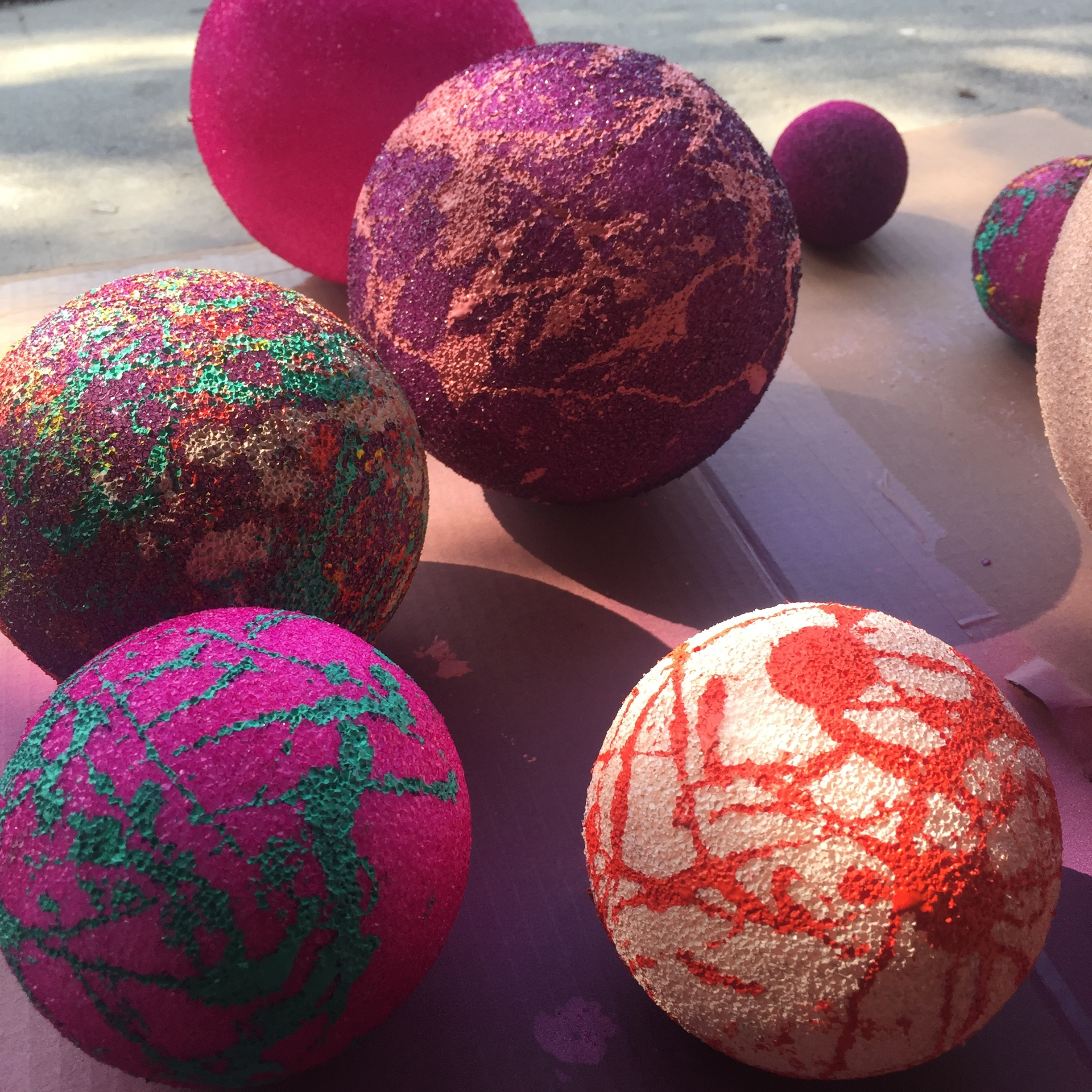 Details of hand-painted balls that are part of the art/window installation created by Parisa Parnian for the SAVAGE MUSE X DIME NAILS collaboration.