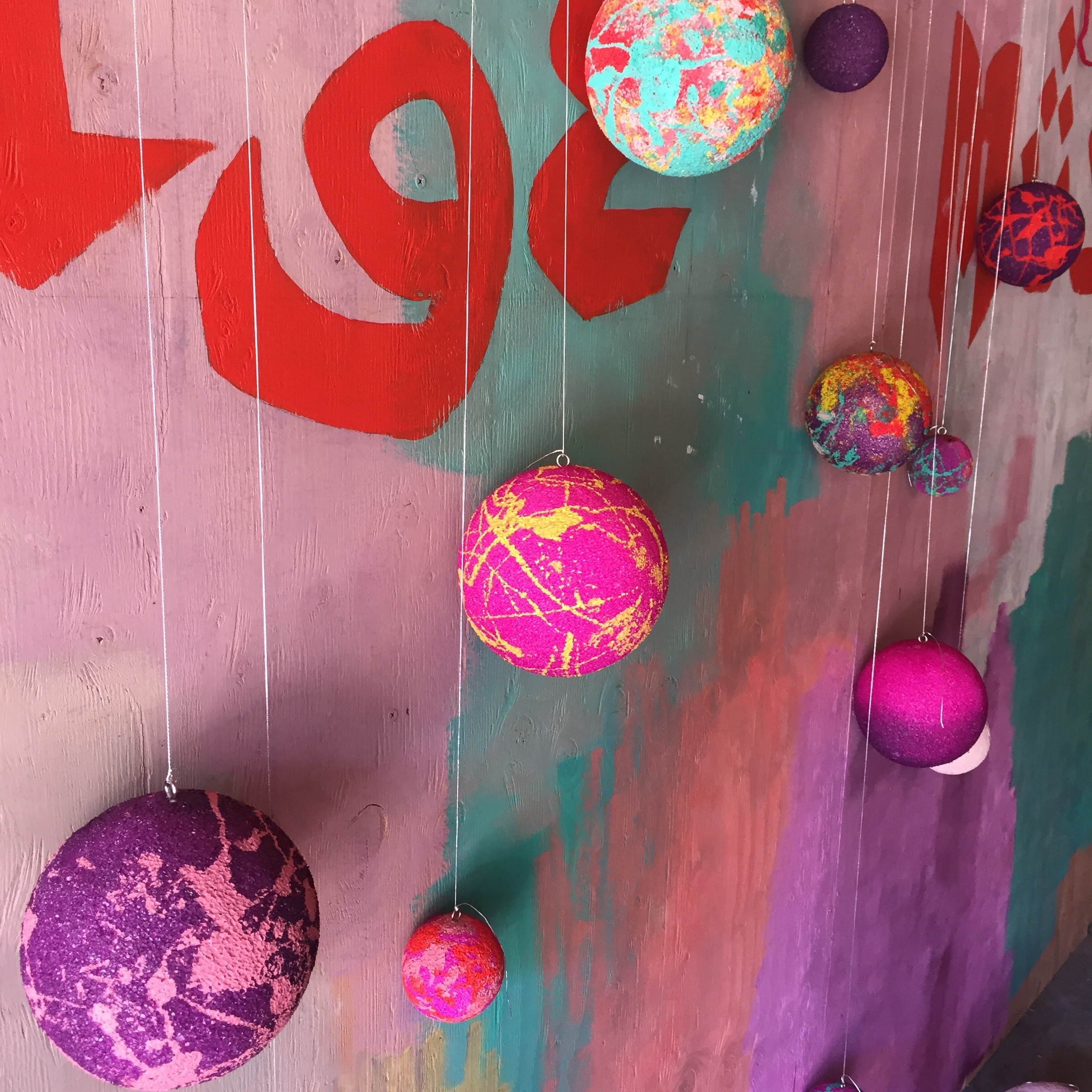 "Hand-painted balls drying in Parisa's ""SAVAGE MUSE"" art studio"