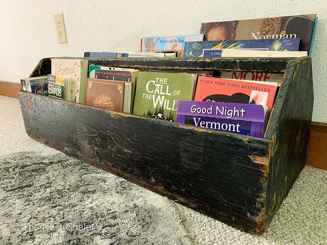 We started building our book collection at The Nest, but we didn't have any way to display them in our loft, which has low walls. A typical book shelf wasn't going to work. Then we found this antique wooden carrier at Stone House Antique Center in Chester, VT and we think it's perfect. ⠀ ⠀ #thenestchalet #reading #vermont #antique #stonehouseantiquescenter #books #booknooks #booksandnooksdecor #woodencarrier #antiquetoolbox #antiquewoodcarrier #readingnook #readingtime #vacationreading #vermontvacation #vermontantiques #vacationvermont #summerinvermont