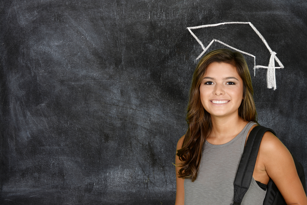 shutterstock_300772346_college student with drawn grad cap.jpg