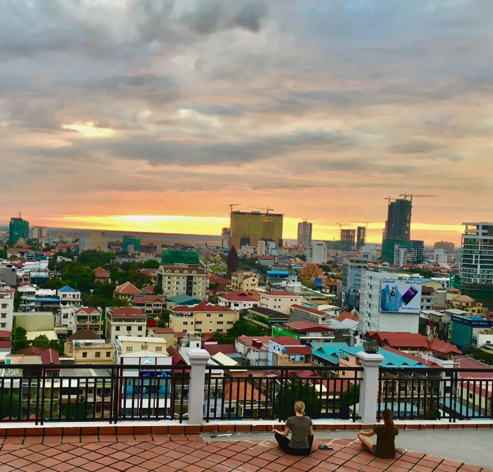 Sunrise Rooftop Meditation in Cambodia. Photo by:  Kathrin Peters