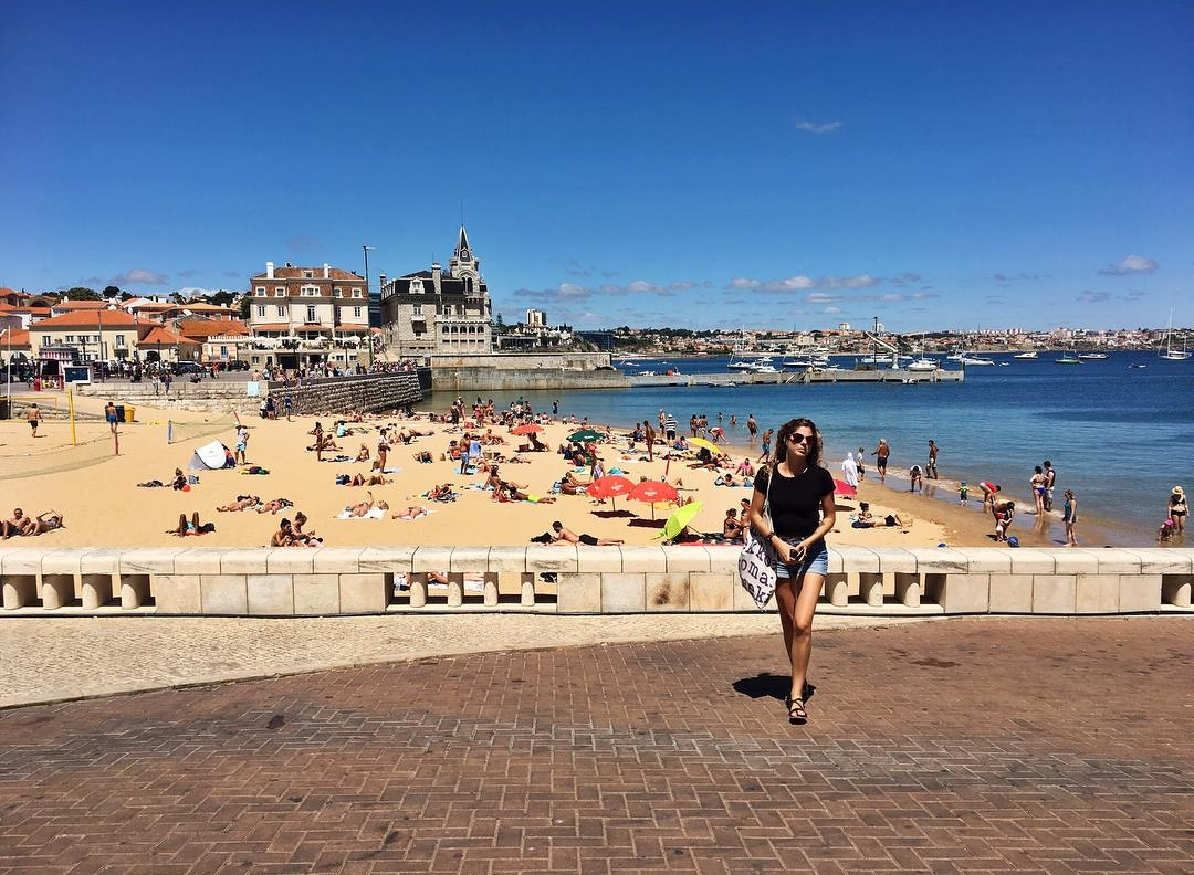 Soaking up a few minutes of Vitamin D in Cascais, Portugal before applying my non-toxic sunscreen. Photo by: Emma Kate