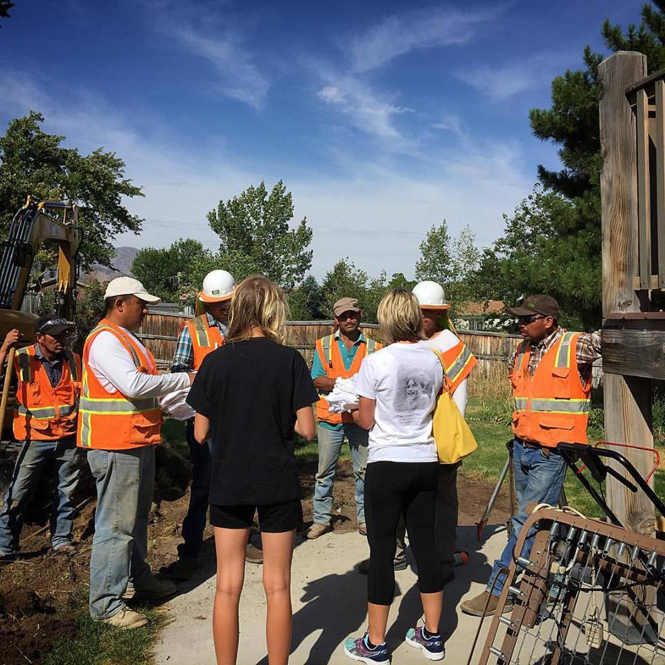 Natalie handing out  #milesformitchell shirts to construction workers who are working on a very special project for a very special DMD family. This is #mitchellsjourney in action. We may not be able to save lives, but we can make those lives special for those who carry heavy burdens.