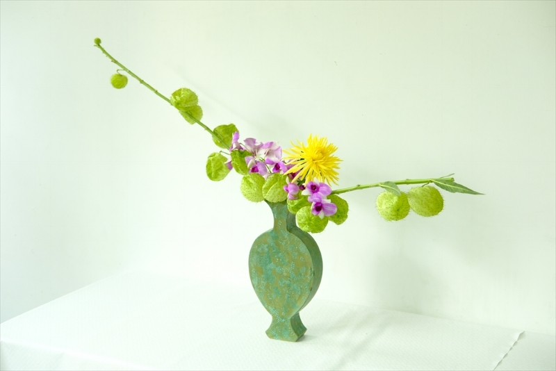 A quick, free-style work that is mimicking the flat dimensions of the vase.