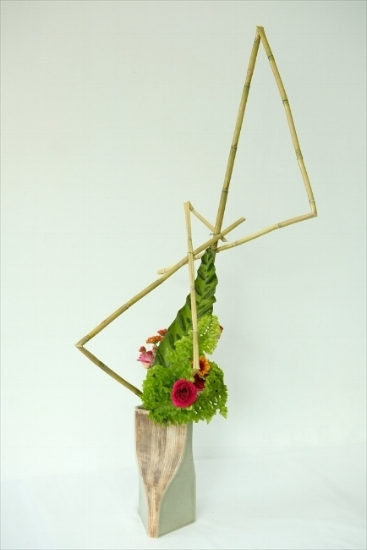 """An arrangement based off of the theme of """"intertwining materials"""" using dried bamboo."""