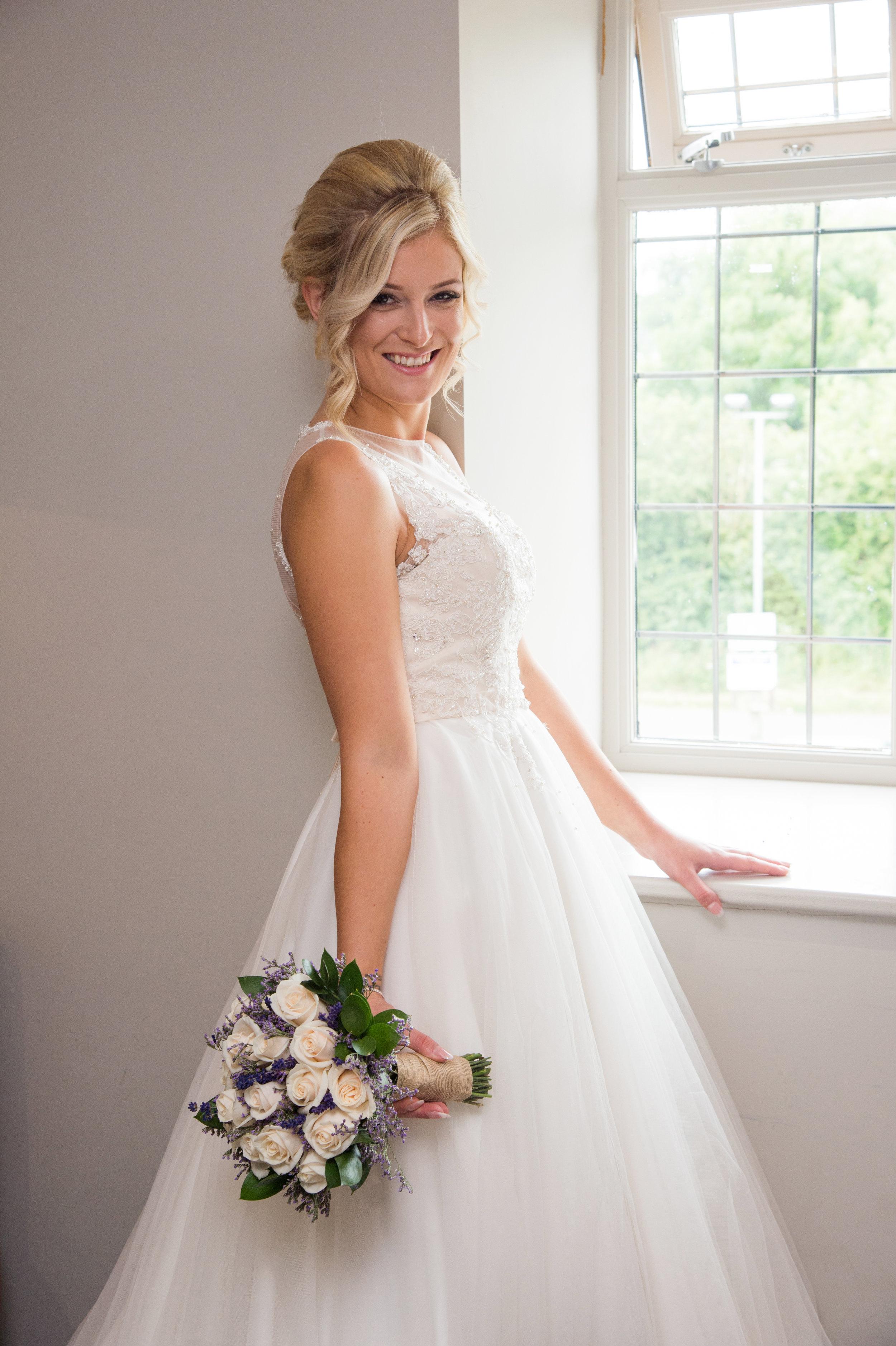 Bride with bouquet Sketchley Grange Hotel Hinckley Leicestershire