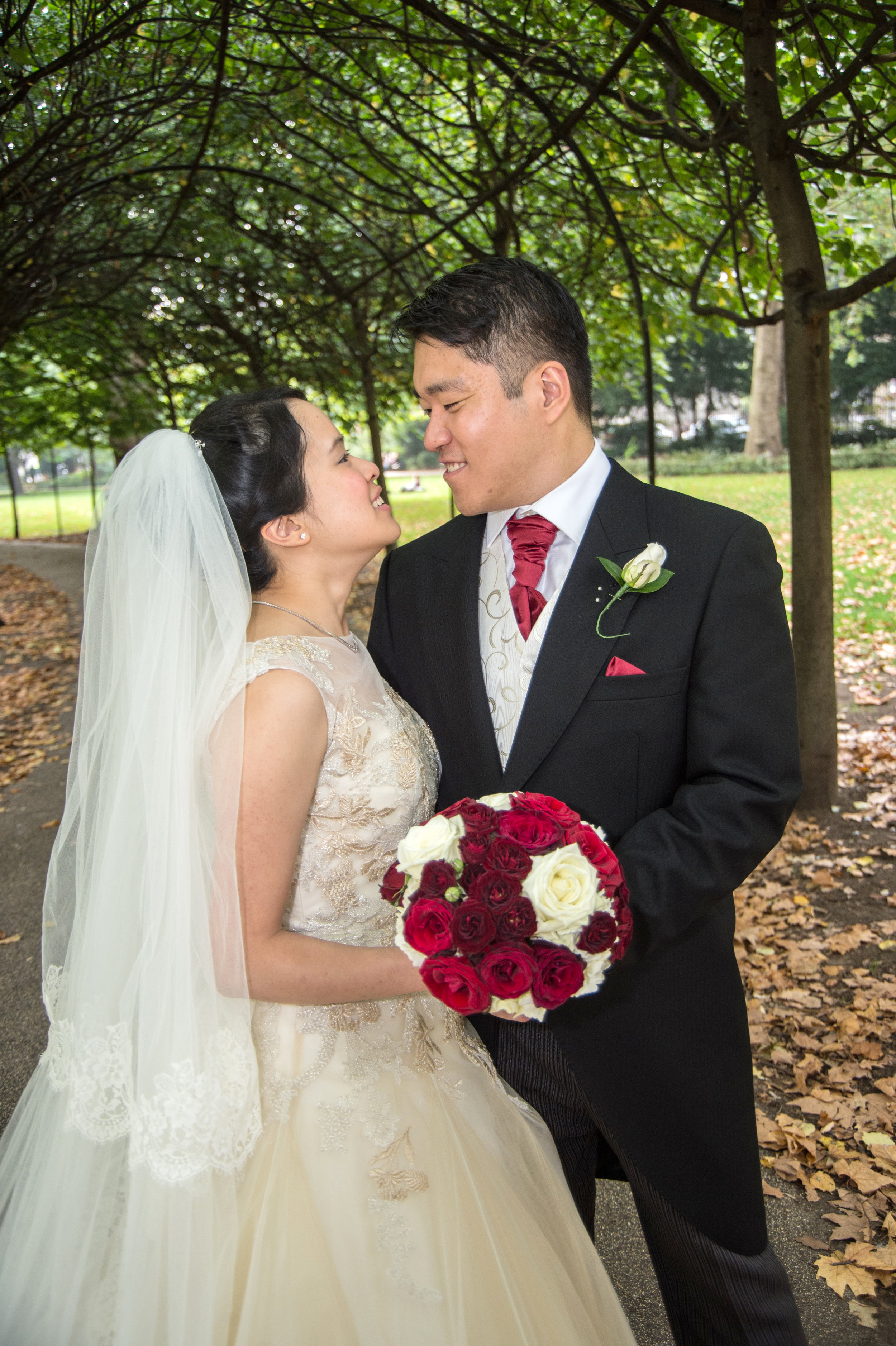 Bride and Groom kiss near Hotel Russell London