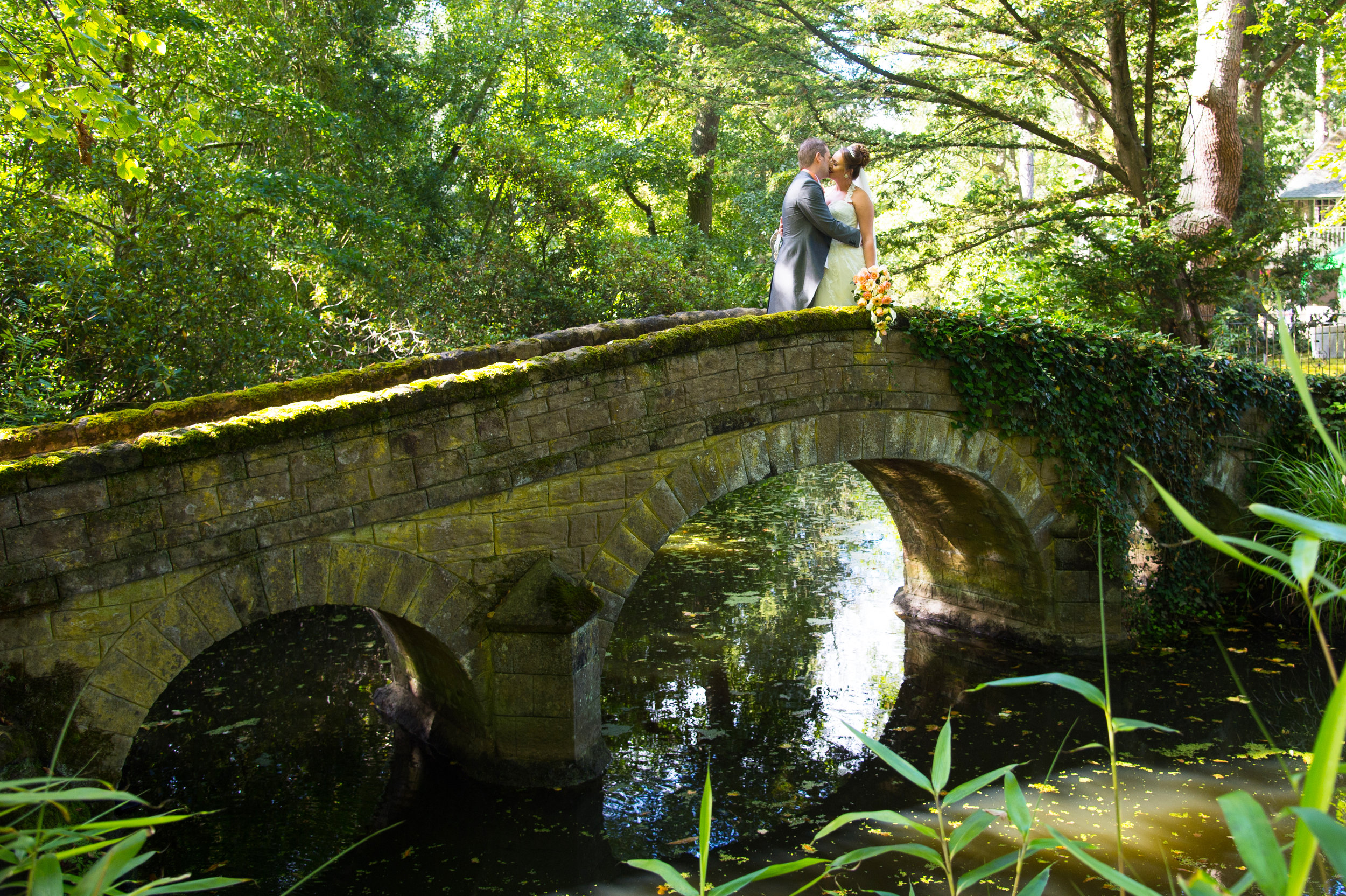 Bride and Groom on Bridge Hogarths Hotel Solihull