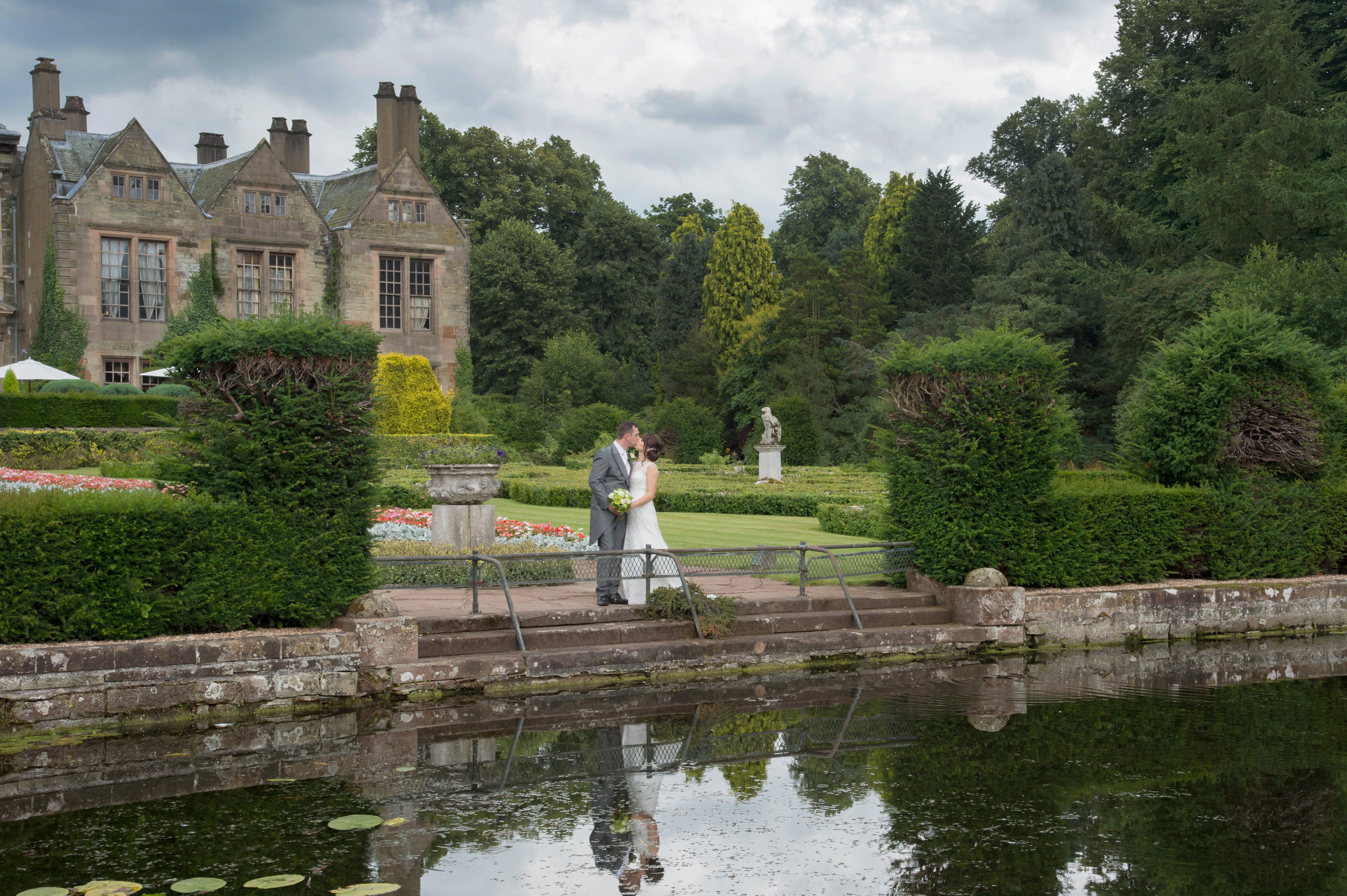 Bride and Groom by the lake Coombe Abbey Hotel Coventry Warwickshire