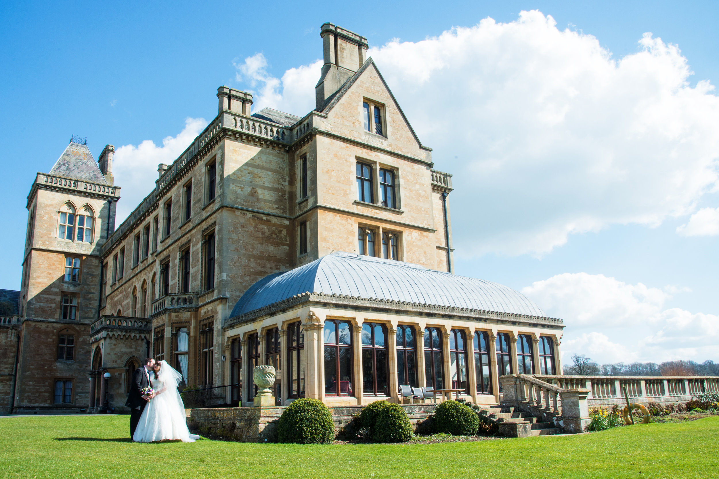 Bride and Groom in front of Walton Hall Hotel Warwickshire