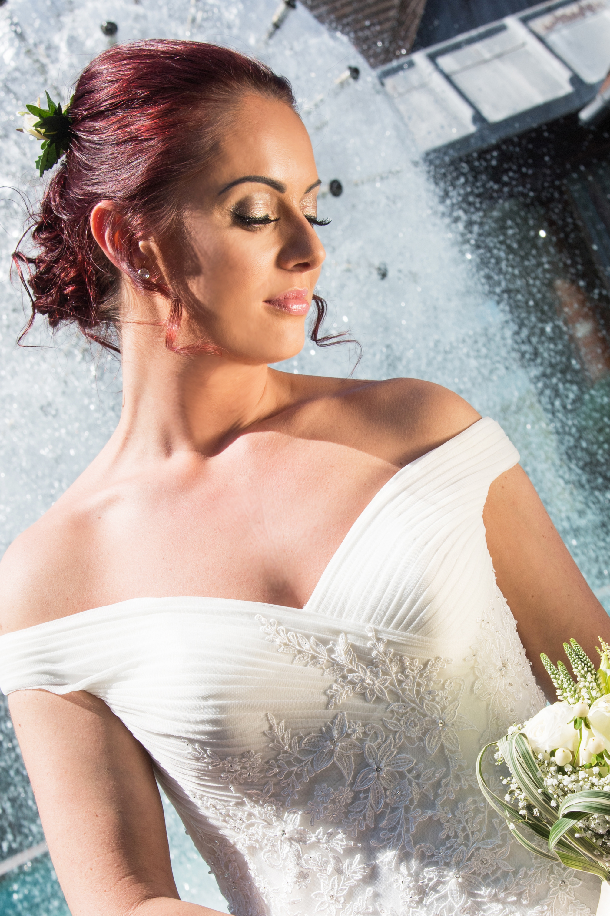 Bride in front of fountain Henley Golf and Country Club