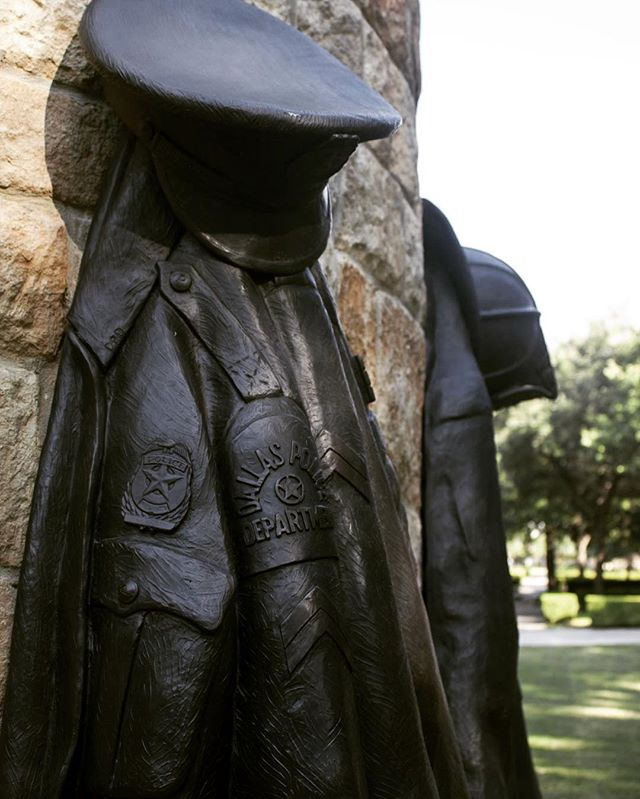 """""""There's a closed-off area dedicated exclusively to officers and firefighters who died in duty. In the center, a just-over-20-foot statue shows an angel holding a police officer in one hand and firefighter in the other — taking each to heaven. At the base of the statue, cast iron police and firefighter uniforms lie wrinkled on hooks, as if these men are done with work for the day and are ready to go home."""" Read the full story on Restland Funeral Home General Manager Mike Day on page 8-9 of the magazine. Photo: Owen Berger"""