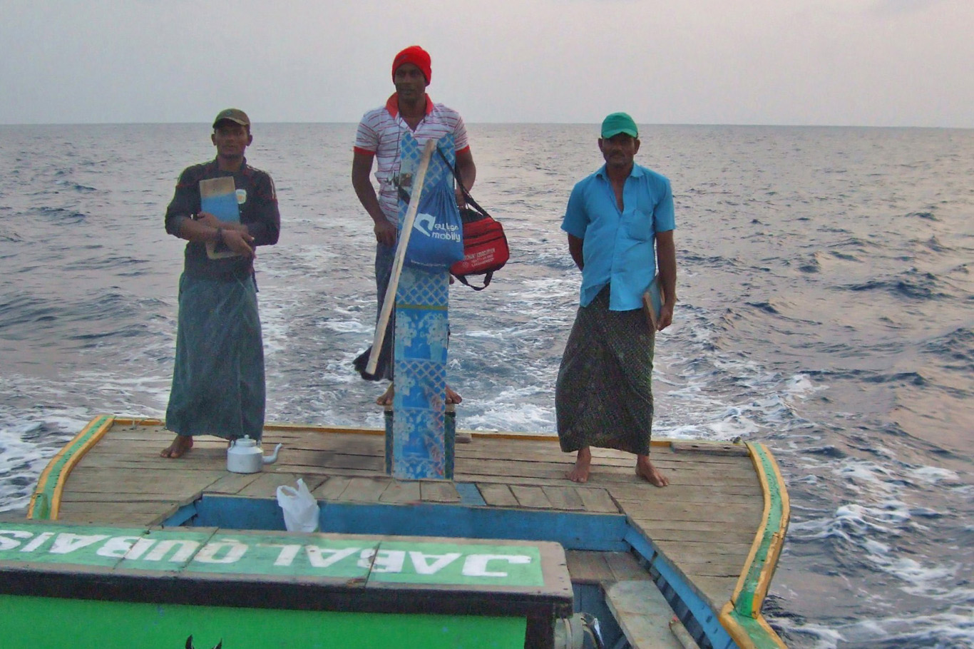 Fishermen and the boat that was used for transfer from Agatti to Kadmat
