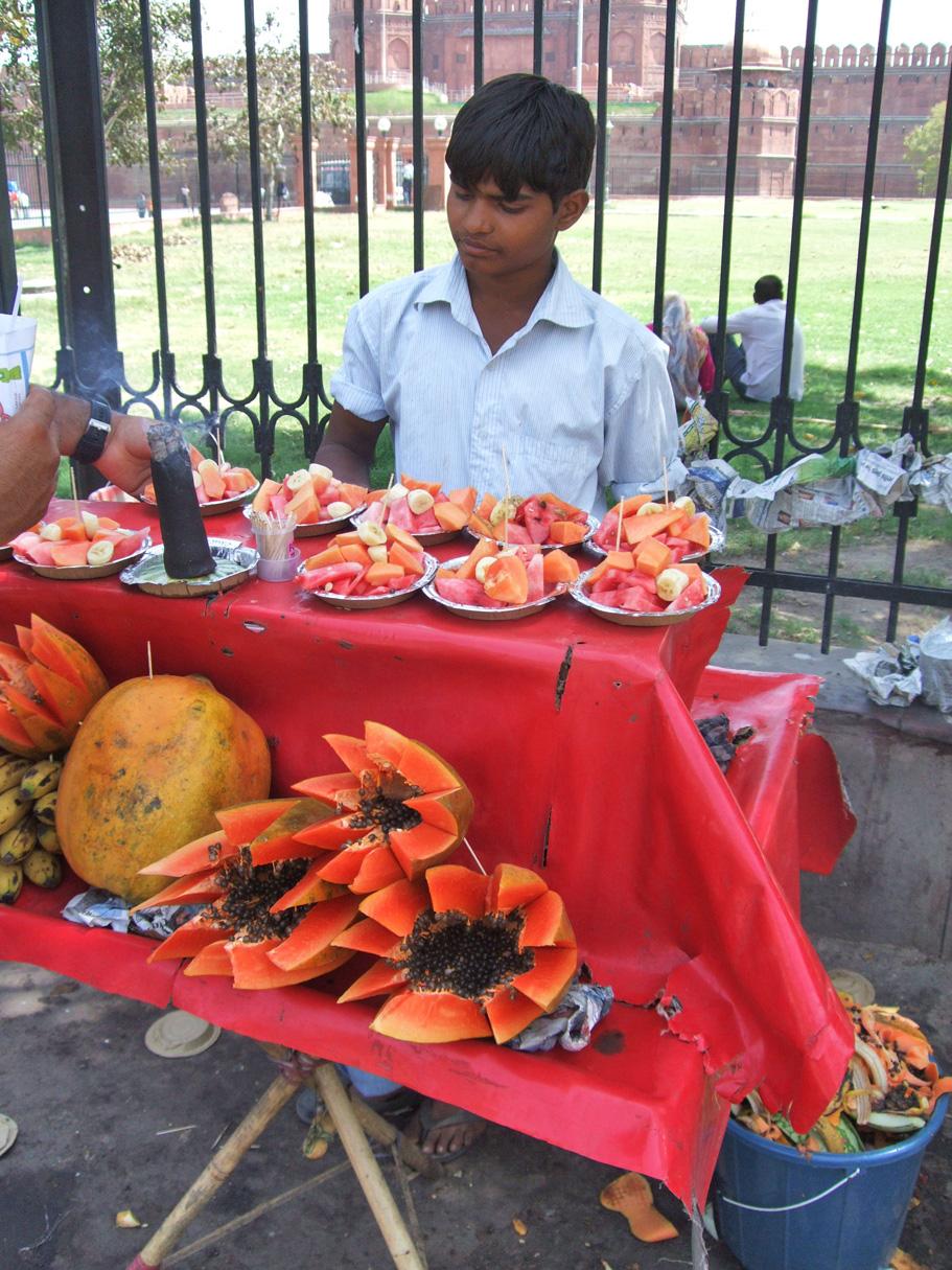 A boy selling fruit in New Delhi