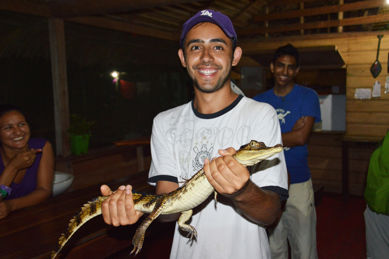 Holding a baby caiman