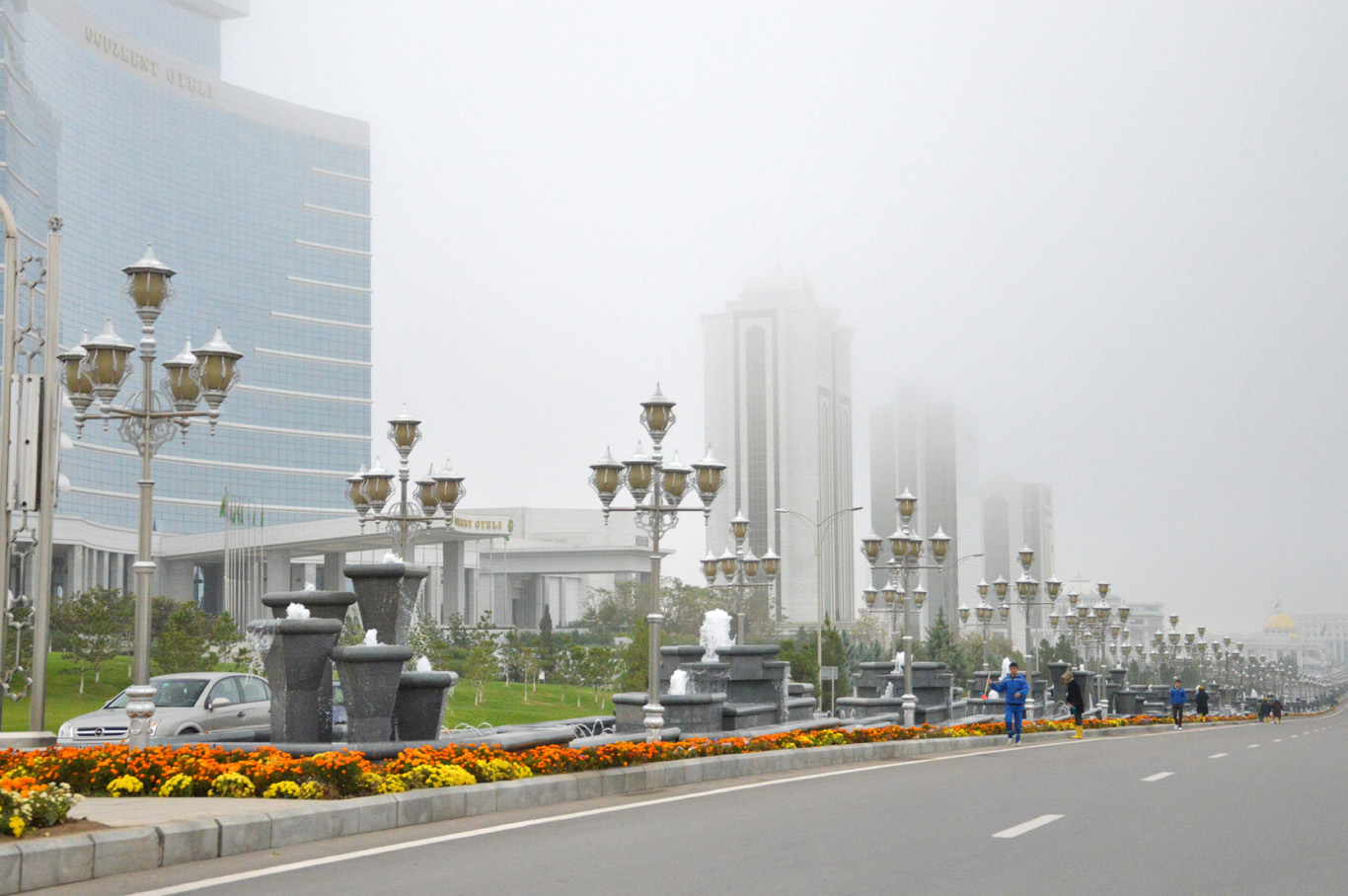 Skyscrapers covered with fog - Street cleaners visible on the left