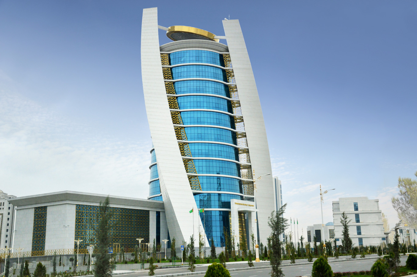 Bank of Turkmenistan - 1 manat coin on top of the building