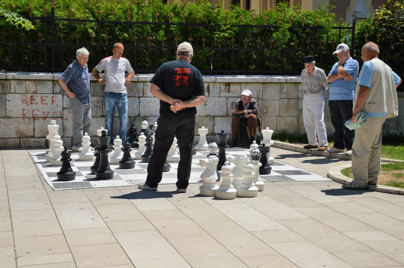 Elderly men playing chess in the street