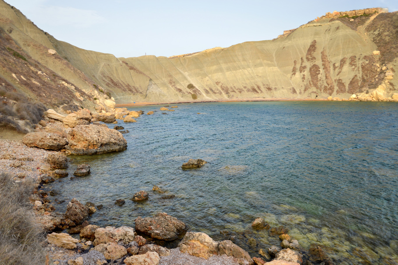 The quiet beach and the barren hills