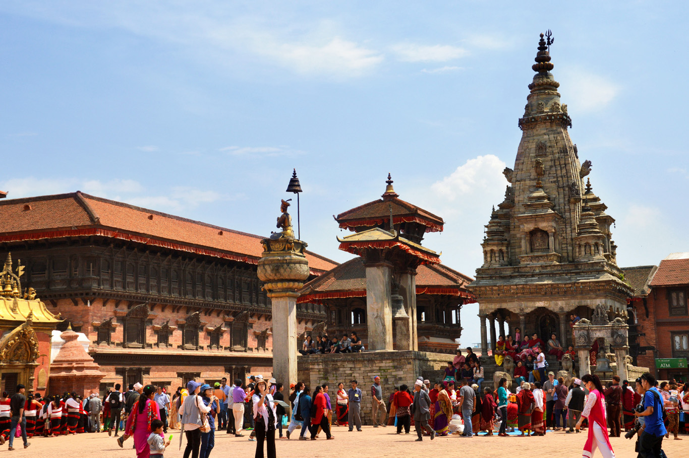 Bhaktapur Durbar Square, from left to right: Golden Gate, 55 Windows Palace, The Big Bell and the tallest temple in the picture - Vatsala Temple (damaged by 2015 earthquake)