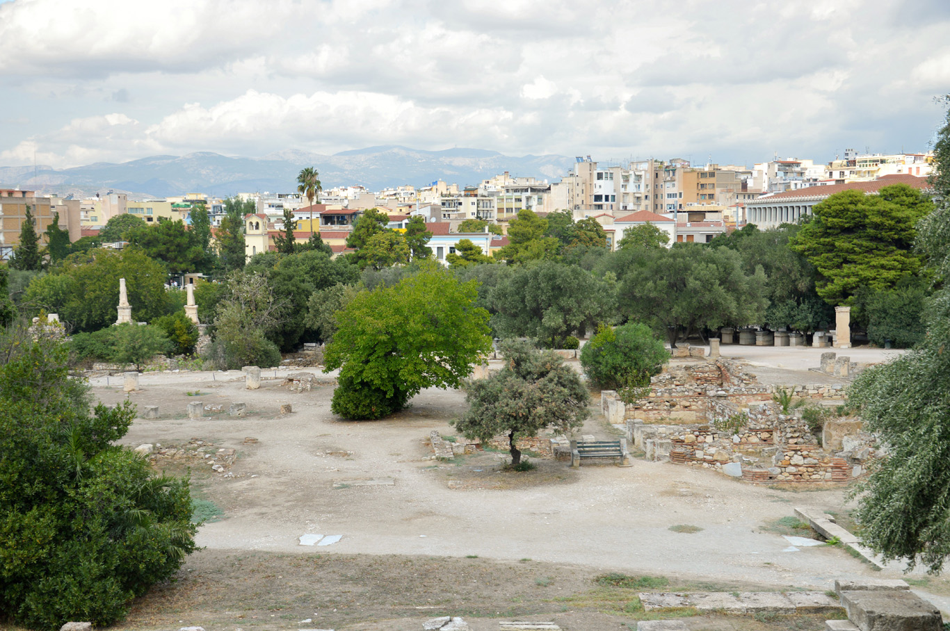 Ancient ruins and modern city in the background