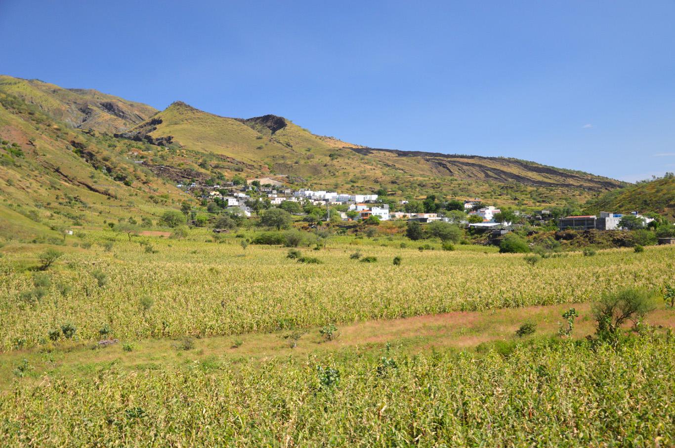 Green slopes before the main caldera